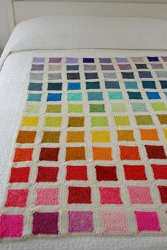 @PurlBee is selling kits to make it easy for others to replicate this beautiful rainbow squares blanket