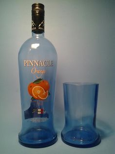"(1) Pinnacle Orange Tall 20-22 oz TUMBLER  GLASS MADE FROM A RECYCLED LIQUOR BOTTLE  *APPROX MEASURES: APPROX. 7 "" TALL X 3.5″ WIDE  *CAPACITY: 20-22 OUNCES  *QUANTITY: ( 1 ) TUMBLER  *The Full bottle shown is used for sizing & scale, therefore not included  with the sale.*"