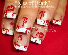 Creepy yet neat blood dripped and bloody lips nail art.