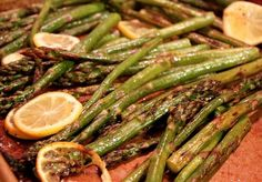 """Lemon Roasted Asparagus    Ingredients:  1 lb. asparagus  2.5 lemons (slice 2 and leave the other one half for juicing)  Olive oil  Salt  Freshly ground black pepper.    Directions:  Preheat oven to 450 degrees.    Prep. your asparagus. Wash and remove the tough ends (cut off approximately 1-2"""" on the non-tree-looking end). If you like, you can reserve these for later to use in a cream of asparagus soup or another one of your favorite dishes. Or if not, just discard.        Lay out asparagus out on a baking sheet. Drizzle with olive oil, sprinkle with salt and freshly ground black pepper. Squeeze the juice of half a lemon on top of asparagus, then add lemon slices. Use your hands to toss and make sure all of the asparagus and lemons are coated nicely with the olive oil, salt and pepper.        Place in the oven for 15-20 minutes until the ends of the asparagus start to become caramelized and slightly browned.        Once asparagus are finished cooking, remove from oven and serve. I like to serve asparagus spears piled up with several lemon slices. My husband is not a huge veggie eater, but he loves this dish. The acidity in the lemons really brings out the deliciously nutty flavor in the roasted asparagus. Try this with fish, chicken or pork or you could even roast some up and add it to your favorite pasta dish!"""