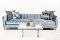 The Manhattan sofa epitomizes the modern loft lifestyle of the 21st century New Yorker. An economy of style and comfort come together in this beautiful, long arm tufted sofa, shown here in Trend Denim