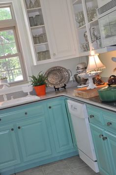 i want to do this in the kitchen, white upper cabinets and a color on the bottom cabinets. turquoise?