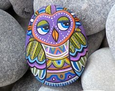 Hand painted pebble owl with very strong Neodymium round Magnet on the back side, make it ideal for decorate your Fridge or make a beautiful gift to your loved ones!  A totally handmade painted stone magnet made by me for all of you !  Is painted on a smooth sea stone which i have collected from a beach on the Greek island of Ikaria. Is painted with fine art quality acrylic colors and very small brushes for the detail , is signed on the back and covert with strong glossy acrylic stone…