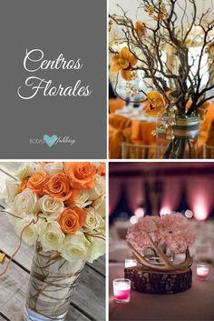 Ramitas y flores para este centro de boda rústica. Arreglos florales sencillos con ramitas. Centro de mesa rústico con hortensias en rosa pálido y cuernos de ciervo sobre una base de madera.