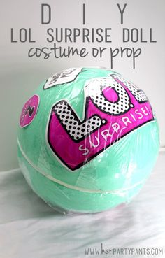 DIY LOL Surprise Doll Costume or Party Centerpiece from www.herpartypants.com. Make your little girl super happy with this big fun ball craft!