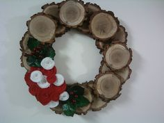 Oak wood slice wreath.  Homemade felt flowers.