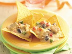 Slow Cooker Southwest Chicken Nachos....i used jalapeno velveeta for the cheese and jalapeno sour cream in place of the southwest ranch sour cream...soooo good! Comparable to Qdoba =]