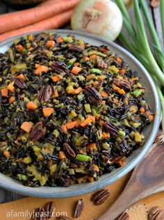 """""""The best Wild Rice recipe - A recipe that lives up to its name! Tender wild rice tossed with vegetables, currants and pecans and cooked in an orange-vermouth broth. Very delicious! Wild Rice Recipes, Vegan Recipes, Cooking Recipes, Cooking Kale, Cooking Bacon, Delicious Recipes, Pasta Recipes, Yummy Food, Roasted Carrots And Parsnips"""