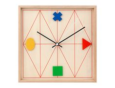 'clock wood geometric' designed by chris collicott for kikkerland