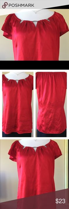 WHBM Red Silk shirt with cut-out neckline Beautiful red silk shirt, three cut-outs on neckline with metal accents.  Cap sleeves.  Vibrant red, great for going out, or ready for your upcoming holiday parties!  White House Black Market Tops Blouses