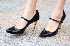 Vince Camuto Callea Black Heels -  Love these shoes.  So classy.  the splash of gold combined with the pointed toe make it such a striking shoe.  VC never fails