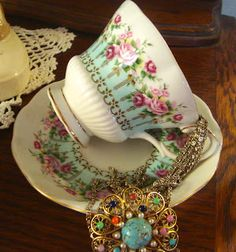 Gorgeous vintage teacup aqua with pink roses- Royal Albert Hyde Park pattern.   Martha's Favorites blog