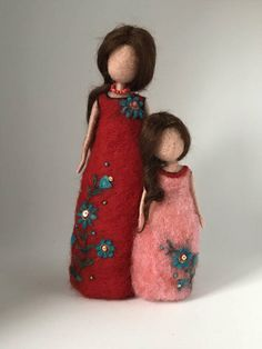 Needle felted doll. There are two gentle images of the mother and daughter. Made in the technique of dry felting with using gold and color beads. I love the ethnic style and in this work I used his colors: red, green, turquoise. The hair is made of silk of dark brown color. Mother and