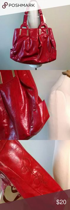 """Jessica Simpson cherry red oversized purse 16x11x4 bright patent leather red shoulder bag with stitching detail and studs. Inside zippered compartment, zippered pocket and two open pockets. Black and beige lining. 10"""" shoulder drop. Minimal wear on bottom seams on outer edge. Jessica Simpson Bags Shoulder Bags"""