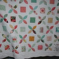 LEMON PEEL QUILT . Alternating applique with square in a square blocks would make a bigger top, fast.