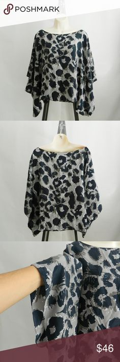 Karen Zambos for Barneys Animal Print Silk Top OS In excellent pre-owned condition Karen Zambos exclusiveley for CO OP Barneys New York silk top. Tagged one size but probably best for up to a size large. Fun animal print, 100% silk, made in the USA. A boat neckline and short batwing sleeves accentuate the airy cut. Gray, white and navy blue. No trades. Open to reasonable offers. Happy Poshing! Karen Zambos Tops Blouses