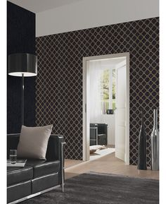 This Opal Geometric Glitter Wallpaper in black and gold features a contemporary geometric pattern infused with subtle glitter. Free UK delivery available