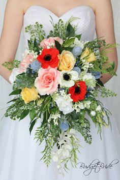 This is a beautiful cascading brides bouquet made with red and white anemones, yellow roses, pink roses and thistles and greenery. Small Bridesmaid Bouquets, Wildflower Bridal Bouquets, Cascading Wedding Bouquets, Red Wedding Flowers, Bride Bouquets, Bridal Flowers, Flower Bouquet Wedding, Floral Wedding, Flower Bouquets