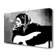 East Urban Home kurt cobain guitar smoke stretched people canvas vivid colour. printed on heavy weight canvas. mounted on to box frame. this kurt cobain guitar smoke people canvas is ready to hang straight from the box. Size: 66 cm H x cm W Kurt Cobain Painting, Kurt Cobain Art, Guitar Drawing, Guitar Art, Frames On Wall, Framed Wall Art, Canvas Artwork, Canvas Prints, Nature Scenes