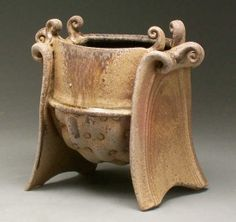 Jake Allee  |  Thrown & altered serving dish.