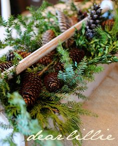 Beautiful natural Christmas decor fill tool boxes and totes with greens pine cones/simple