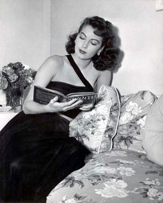 Ava Gardner reading on the set of The Bribe (1949).
