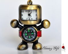 Antiqued cute robot with compass Pocket Watch Necklace. $3.99, via Etsy.  http://www.etsy.com/listing/80987519/antiqued-cute-robot-with-compass-pocket
