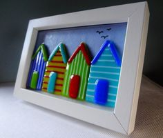 Hey, I found this really awesome Etsy listing at https://www.etsy.com/listing/209336443/fused-glass-colourful-beach-huts-in-a