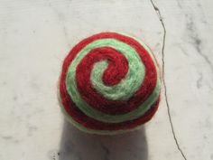 One multi-colored felted pin-cushion, Red and Mint Green by Dreamcrafter on Etsy