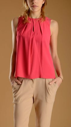 Asymmetric front keyhole sleeveless pleated fuchsia top featuring a silk armhole and a keyhole neck with button fastening at the back, 65% acetate, 35% silk lining