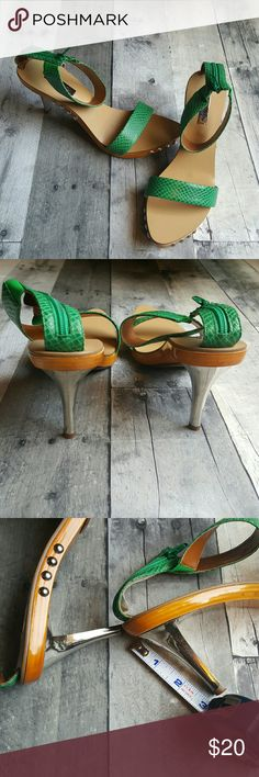 Leather Strap Green Heels The cute and comfy heels are perfect for Spring.  Brand: DOLLHOUSE Style: Real  Condition: Good condition worn once.  Flaws: Various scratches on the shoe as shown in the pictures with most of them underneath which can't be seen when worn.  Size 8 Footbed is 9 inches from back to longest point  Color: Green Leather, Wood Sole with Silver Tone Heel Material: Leather Upper Balance, Man made materials Dollhouse Shoes Heels