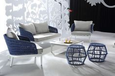 """Renava Buenos Modern Outdoor Sofa Set. The Renava Buenos Modern Outdoor Sofa Set exhibits a sprightly appeal in white powder coated aluminum frame covered in dainty blue and grey weatherproof strapping. Adding to its charm are the cushy grey cushions and the 8 mm white tempered glass top of the coffee table. Dimensions: Sofa: W63"""" x D35"""" x H28""""  Chair: W27"""" x D35"""" x H28""""  Coffee Table: W43"""" x D24"""" x H11""""  Additional Information:"""