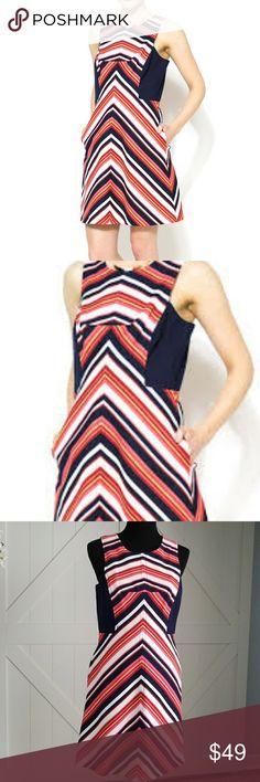 Trina Turk Beach Stripe  A-line Flare Dress Trina Turk Beach milti-colored stripe A-line flare dress, navy colored blocked solid insets at sides, finished with an A-line skirt and straight hem. In-seam pockets, hidden back zipper closure. Trina Turk Dresses Midi
