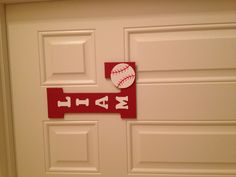Wooden letters spray painted and added a baseball for a sports theme and hung on bedroom door