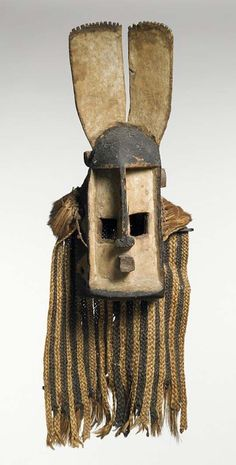 A Dogan face mask from the Sanga, Mopti region of Mali.  Early 20th century. Wood, natural fibers and pigment.