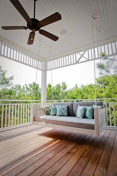 Perfect porch swing. House of Turquoise: WaterColor Beach Home