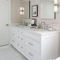 The white-brown bathroom has a white double vanity with … White and tan bathroom features a white dual sink vanity topped with off white quartz fitted with his and hers sinks and gooseneck faucets under inset frameless medicine cabinets alongside a white Tan Bathroom, Marble Bathroom Floor, White Marble Bathrooms, Simple Bathroom, Bathroom Colors, Master Bathroom, Bathroom Designs, Narrow Bathroom, Marble Floor