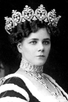 Helena Montagu, Duchess of Manchester (born Helena Zimmerman; later Lady Kintore) wears the Manchester Tiara, made by Cartier in 1903, for the coronation of King George V of the United Kingdom in 1911; the tiara is now on permanent display at the Victoria and Albert Museum in London