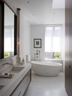 Bright Bathroom Interior With Clean White Wall Paint And Completed With White Freestanding Bathtub And Astounding Vanity Plus Gorgeous Large Mirror Modern Bathroom Design, Bathroom Interior Design, Bathroom Designs, Bath Design, Interior Doors, Sink Design, Cleaning White Walls, All White Bathroom, White Bathrooms