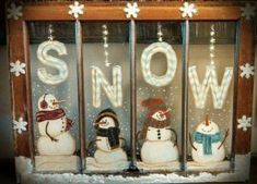 Snowmen painted on old window. by kristy