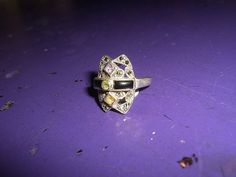 """Vintage sterling silver ring  Excellent condition  This ring was meant to bring strength and good fortune  Amethyst, Citrine, Peridot, and Onyx elegantly set  Clearly marked, """"NF 925"""" $45.00"""