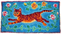 """""""Rosie the Flying Cat"""" hand hooked rug by Ruth Robinson using mostly recycled T-shirts.  I want that blue dye formula!"""