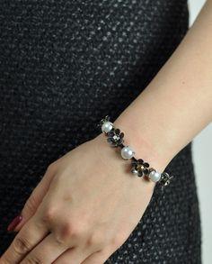 $70 Grey Swarovski Crystals Pearly Floral Bracelet by Miss Julie  Shop here: http://www.trendcy.com/grey-swarovski-crystals-pearly-floral-bracelet/