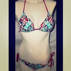Billabong red, white and blue bikini set Has been worn before but still in good condition. Will sell top / bottom separately if requested. Bottom has silver chained hearts attached. Back of bottoms are a little faded and worn but still in good condition. Billabong Swim Bikinis