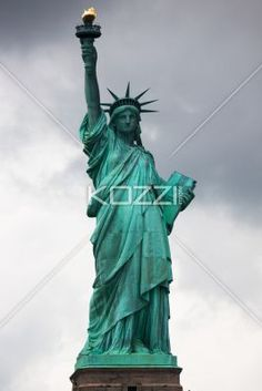 low angle view of statue of liberty. - Low angle view of Statue of Liberty against cloudy sky.