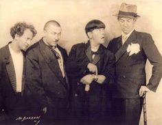 Three stooges (with a mustachioed Curly Howard) and Ted Healy