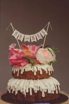 bundt cake with bunting, photo by Amy Zumwalt Photography http://ruffledblog.com/dallas-arboretum-wedding #weddingcake #cakes