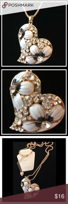 """Beautiful Black & White Floral Heart Necklace Gorgeous rhinestone encrusted pendant with black and white flowers. Pendant measures 1.8"""" x 1.8"""". Gold rope chain is 26@ with a 2"""" extender. NEW Jewelry Necklaces"""