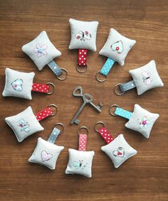 Items similar to Applique fabric keyrings key holder key fob Embroidery bag charm new home keychain free motion embroidery House moving gift New Home on Etsy Embroidery Bags, Free Motion Embroidery, Small Sewing Projects, Sewing Crafts, Diy Bag Charm, Moving Gifts, Applique Fabric, Fabric Gifts, Felt Crafts