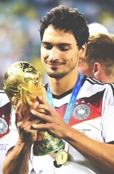 "Mats Hummels looking lovingly at the World Cup trophy.  He's like,""Yes, I like you.  I will keep you"""